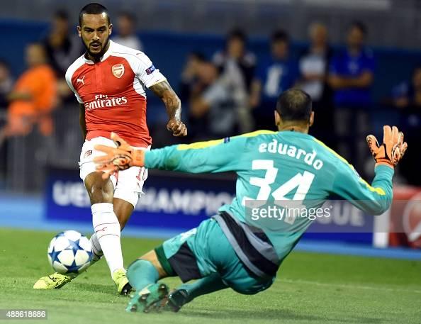 Arsenal's forward Theo Walcot scores past Dinomo's goalkeeper Eduardo during their UEFA Champions League Group F football match between GNK Dinamo...