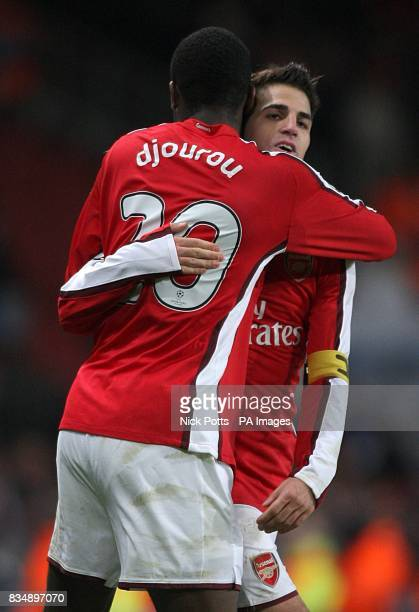 Arsenal's Francesc Fabregas and Johan Djourou celebrate after the final whistle