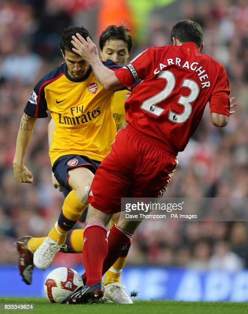 Arsenal's Francesc Fabregas and Liverpool's Jamie Carragher in action
