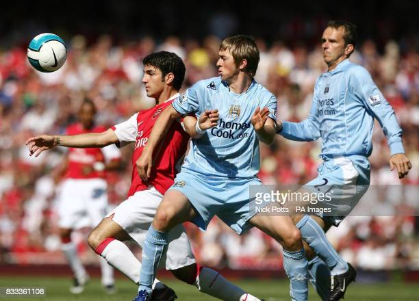Arsenal's Francesc Fabregas and Manchester City's Michael Johnson during the Barclays Premier League match at the Emirates Stadium London