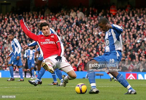 Arsenal's Francesc Fabregas and Wigan Athletic's Titus Bramble battle for the ball