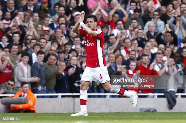 Arsenal's Francesc Fabregas applauds the fans after being substituted