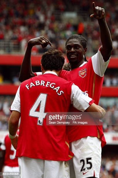 Arsenal's Francesc Fabregas celebrates after scoring the fourth goal of the game with team mate Emmanuel Adebayor