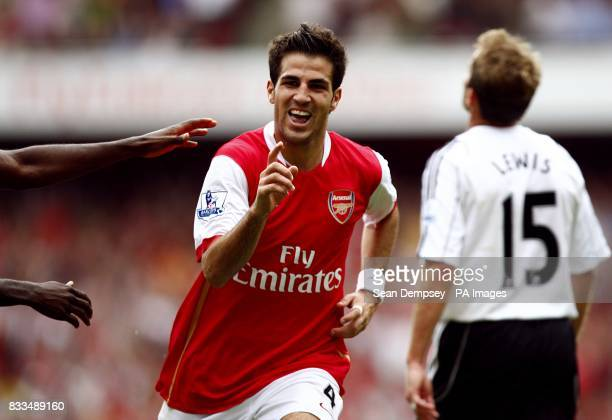 Arsenal's Francesc Fabregas celebrates after scoring the fourth goal of the game as Derby County's Eddie Lewis looks on dejected