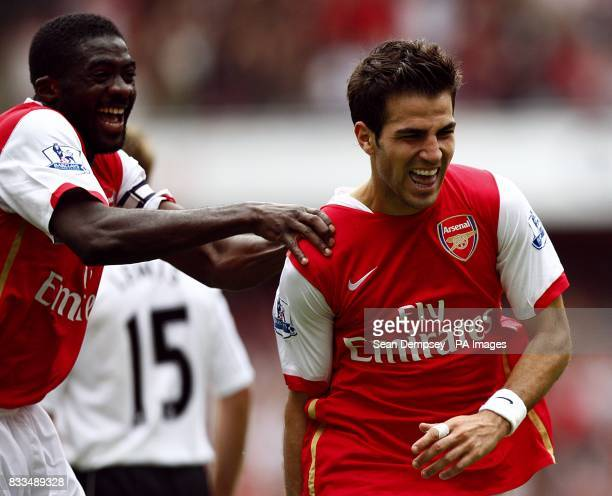 Arsenal's Francesc Fabregas celebrates after scoring the fourth goal of the game with team mate Kolo Toure