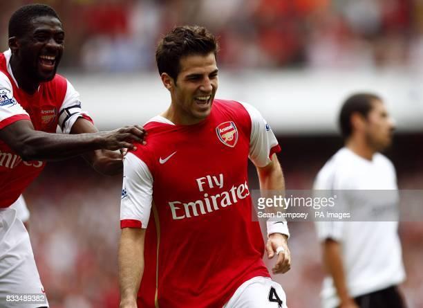 Arsenal's Francesc Fabregas celebrates after scoring the fourth goal of the game with team mate Kolo Toure