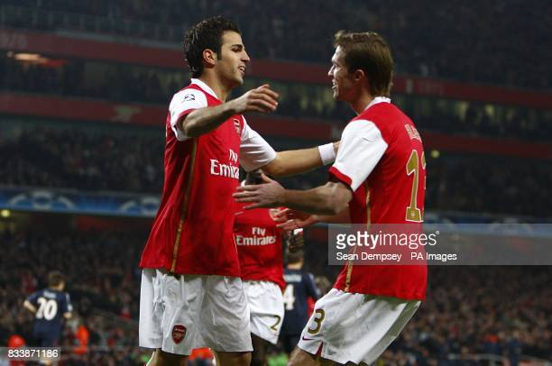 Arsenal's Francesc Fabregas celebrates scoring the first goal of the game with team mate Alexander Hleb