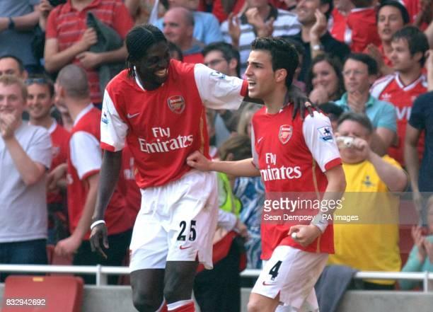 Arsenal's Francesc Fabregas celebrates scoring their second goal with teammate Emmanuel Adebayor