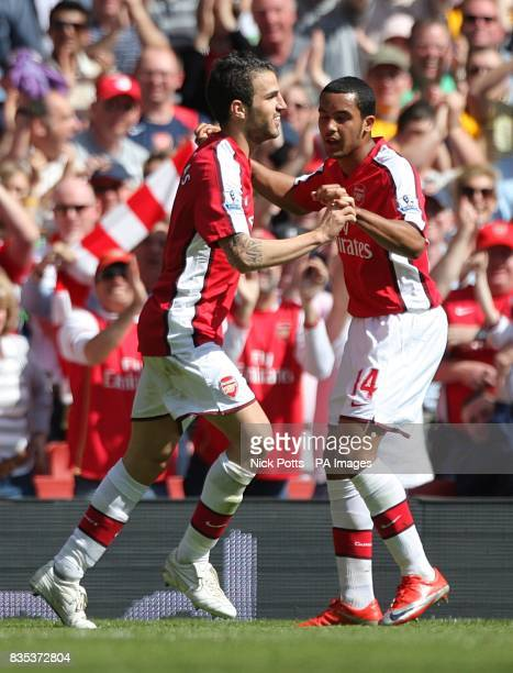 Arsenal's Francesc Fabregas celebrates with team mate Theo Walcott after he scores his and his sides second goal of the game