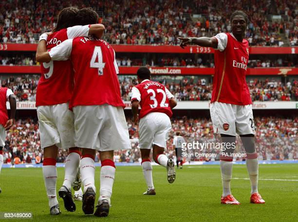 Arsenal's Francesc Fabregas celerbates with team mates Da Silva Eduardo and Emmanuel Adebayor after scoring the fourth goal of the game