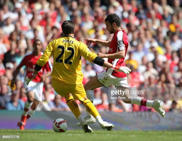 Arsenal's Francesc Fabregas gets past Middlesbrough goalkeeper Brad Jones to score his and his sides second goal of the game