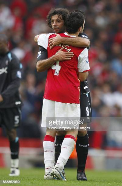Arsenal's Francesc Fabregas hugs Bolton Wanderers' Ivan Campo after the final whistle