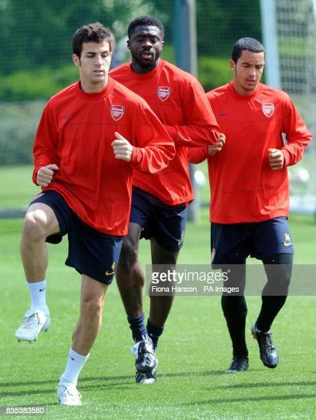 Arsenal's Francesc Fabregas Kolo Toure and Theo Walcott during a training session at London Colney Training Ground London