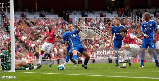 Arsenal's Francesc Fabregas scores the second goal during the Barclays Premier League match at the Emirates Stadium London