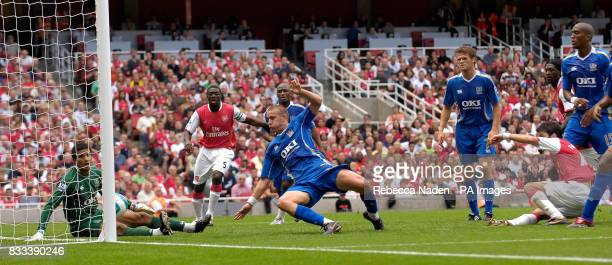 Arsenal's Francesc Fabregas scores the second goal of the game during the Barclays Premier League match at the Emirates Stadium London