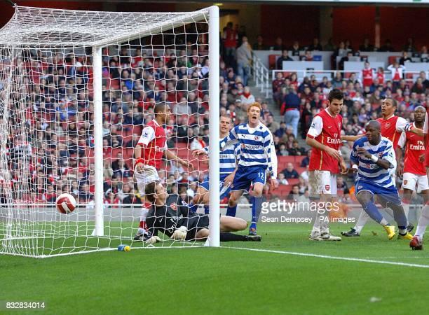 Arsenal's Francesc Fabregas stands dejected after scoring an own goal