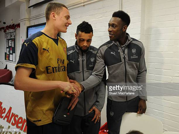 Arsenal's Francis Coquelin and Danny Welbeck during a visit to charity Centre 404 on December 22 2016 in London England