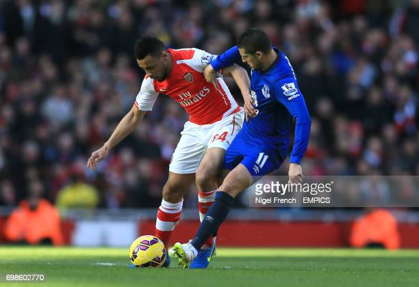 Arsenal's Francis Coquelin and Everton's Kevin Mirallas battle for the ball