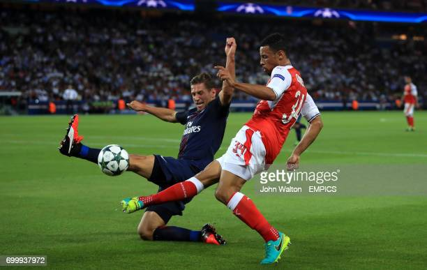 Arsenal's Francis Coquelin and Paris SaintGermain's Grzegorz Krychowiak battle for the ball