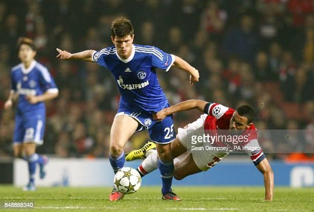 Arsenal's Francis Coquelin and Schalke 04's KlaasJan Huntelaar battle for the ball