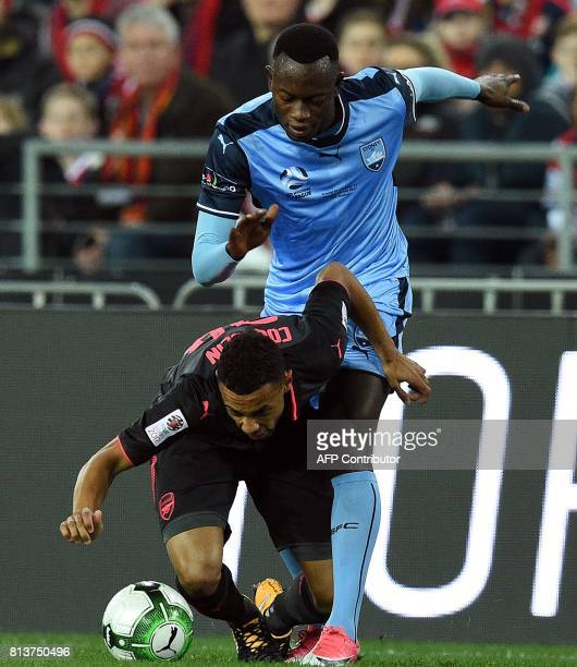 Arsenal's Francis Coquelin and Sydney FC's Charles Lokolingoy fight for the ball during a preseason football friendly match against Sydney FC on July...