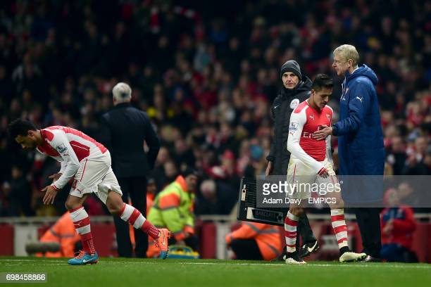 Arsenal's Francis Coquelin replaces teammate Arsenal's Alexis Sanchez who receives a pat on the chest from manager Arsene Wenger
