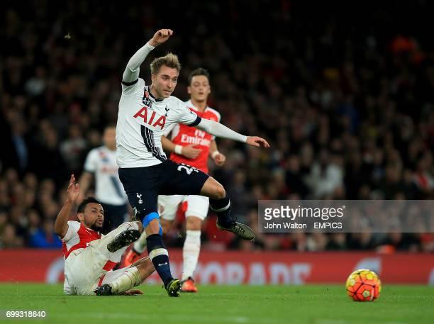 Arsenal's Francis Coquelin slides in on Tottenham Hotspur's Christian Eriksen