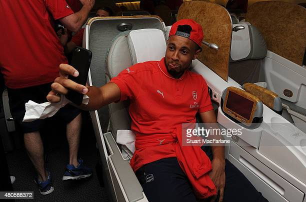 Arsenal's Francis Coquelin takes a selfie on the Arsenal plane as they travel to Singapore for the Barclays Asia Trophy at Stansted Airport on July...