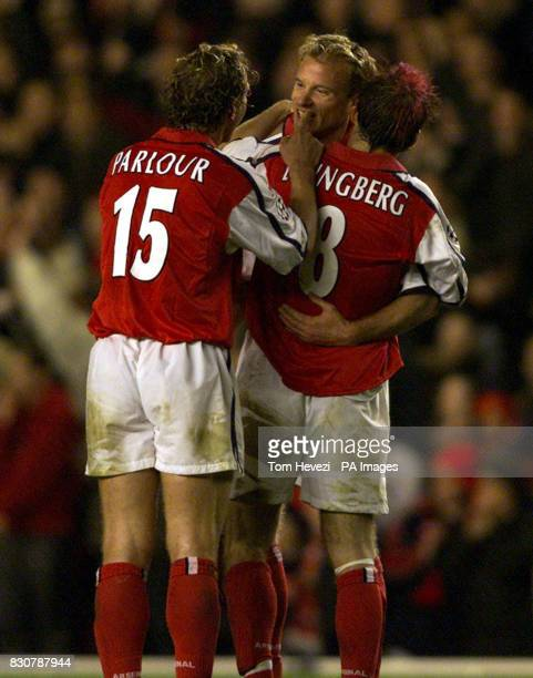 Arsenal's Freddie Ljungberg celebrates with Dennis Bergkamp who set up the goal that made the score 31 during the Champions League match at Highbury...