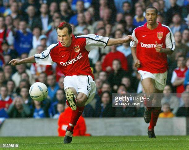 Arsenal's Freddie Ljungberg shoots to score the second goal against Chelsea in The FA Cup against Chelsea at The Millenium Stadium in Cardiff 04 May...