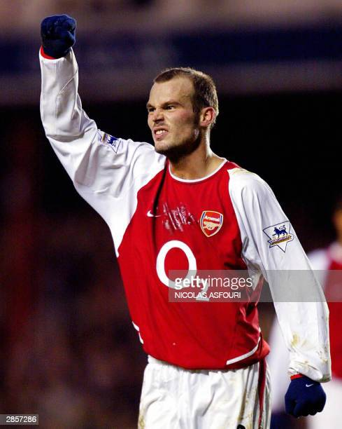 Arsenal's Fredrik Ljunberg celebrate his goal at Highbury in London 10 January 2004 during a Premiership match against Middlesbrough Arsenal won 41...