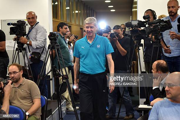 Arsenal's French coach Arsene Wenger arrives for a press conference ahead of the UEFA Champions League Group F football match between GNK Dinamo...