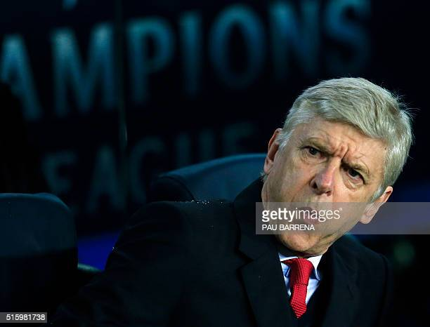 Arsenal's French coach Arsene Wenger gestures no his bench before the UEFA Champions League Round of 16 second leg football match FC Barcelona vs...