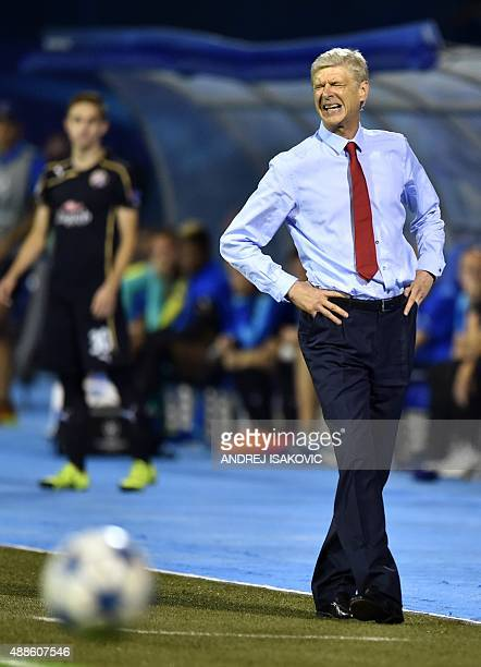 Arsenal's French Coach Arsene Wenger reacts during the UEFA Champions League Group F football match between GNK Dinamo Zagreb and Arsenal FC at...