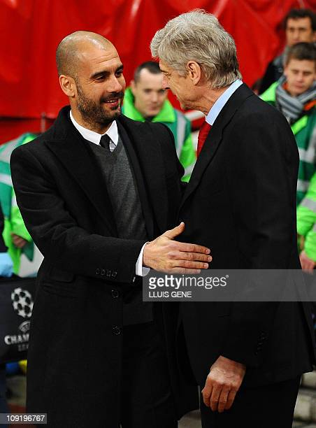 Arsenal's French coach Arsène Wenger welcomes to Barcelona's coach Pep Guardiola before their Champions League round of 16 1st leg football match...