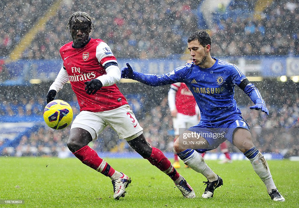 "Arsenal's French defender Bacary Sagna (L) vies with Chelsea's Belgian midfielder Eden Hazard (R) during their English Premier League football match against Arsenal at Stamford Bridge in London, England on January 20, 2013. USE. No use with unauthorized audio, video, data, fixture lists, club/league logos or ""live"" services. Online in-match use limited to 45 images, no video emulation. No use in betting, games or single club/league/player publications."