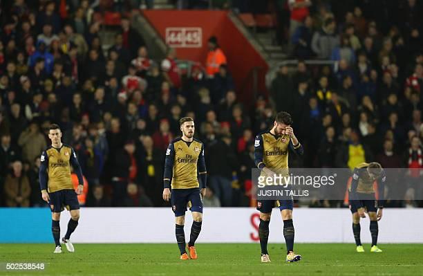 Arsenal's French defender Laurent Koscielny Arsenal's Welsh midfielder Aaron Ramsey Arsenal's French striker Olivier Giroud and Arsenal's Spanish...