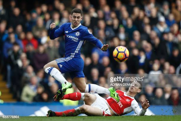 Arsenal's French defender Laurent Koscielny cuts out a through ball intended for Chelsea's Belgian midfielder Eden Hazard during the English Premier...
