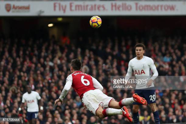Arsenal's French defender Laurent Koscielny dives for the ball during the English Premier League football match between Arsenal and Tottenham Hotspur...