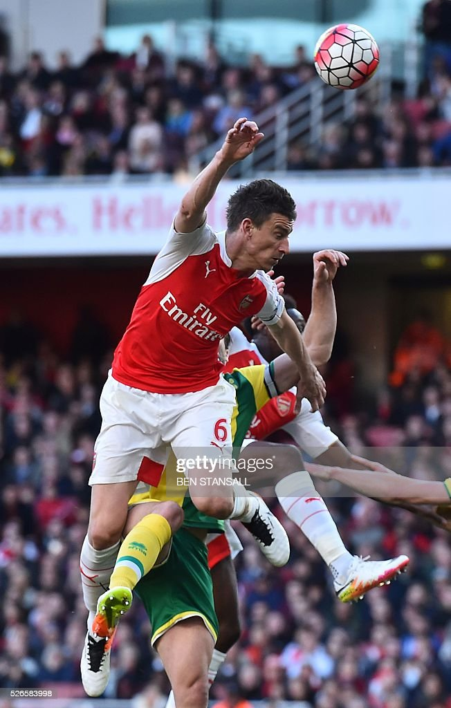 Arsenal's French defender Laurent Koscielny heads the ball during the English Premier League football match between Arsenal and Norwich at the Emirates Stadium in London on April 30, 2016. / AFP / BEN STANSALL / RESTRICTED TO EDITORIAL USE. No use with unauthorized audio, video, data, fixture lists, club/league logos or 'live' services. Online in-match use limited to 75 images, no video emulation. No use in betting, games or single club/league/player publications. /