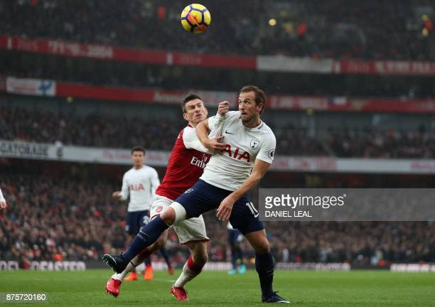Arsenal's French defender Laurent Koscielny vies with Tottenham Hotspur's English striker Harry Kane during the English Premier League football match...