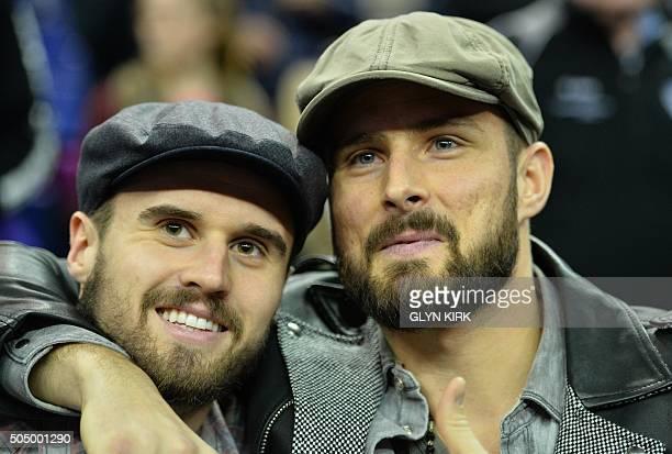 Arsenal's French forward Olivier Giroud and Carl Jenkinson watch the NBA Global Game London 2016 basketball match between Orlando Magic and Toronto...