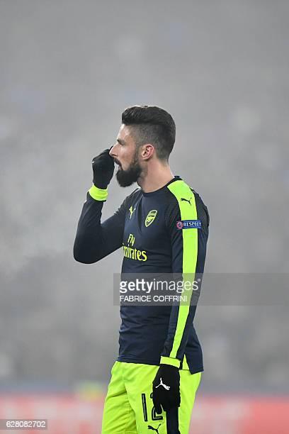 Arsenal's French forward Olivier Giroud looks on at the end of the UEFA Champions league Group A football match between FC Basel 1893 and Arsenal FC...