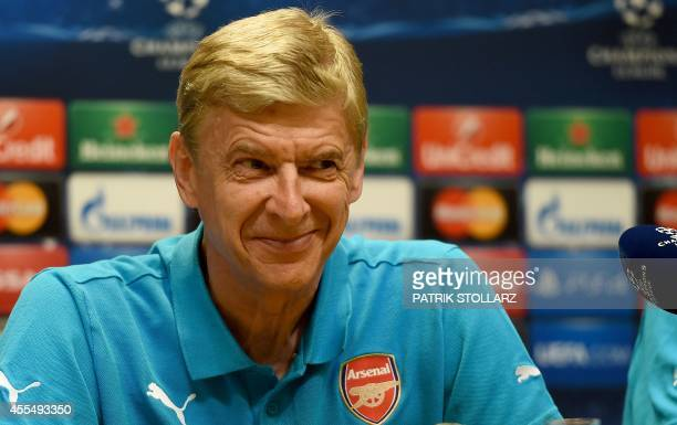 Arsenal´s French head coach Arsene Wenger answers questions during a press conference in Dortmund western Germany on September 15 on the eve of the...
