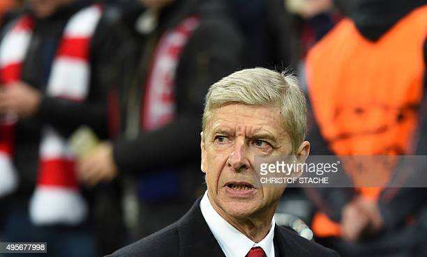 Arsenal's French headcoach Arsene Wenger arrives for the UEFA Champions League Group F secondleg football match between FC Bayern Munich and Arsenal...