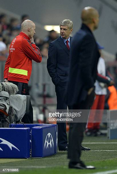 Arsenal's French manager Arsene Wenger and Bayern Munich's Spanish head coach Pep Guardiola watch the UEFA Champions League last 16 second leg...