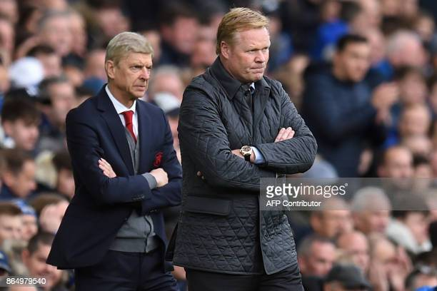 Arsenal's French manager Arsene Wenger and Everton's Dutch manager Ronald Koeman watch from the touchline during the English Premier League football...