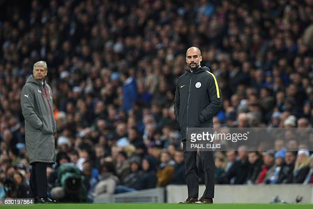 Arsenal's French manager Arsene Wenger and Manchester City's Spanish manager Pep Guardiola watch the game from the touchline during the English...