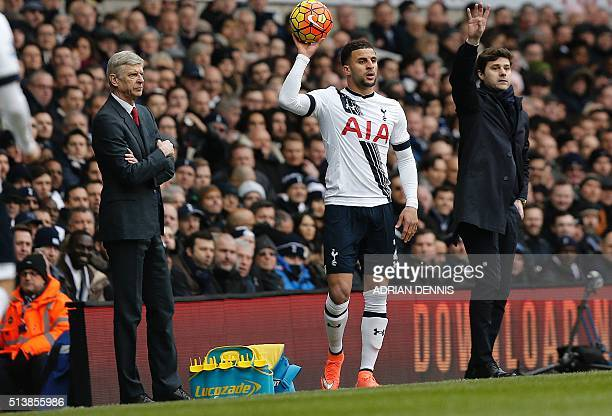 Arsenal's French manager Arsene Wenger and Tottenham Hotspur's Argentinian head coach Mauricio Pochettino watches their players from the touchline...