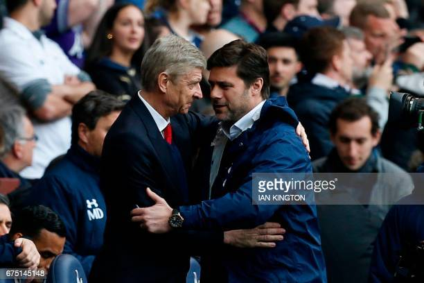 Arsenal's French manager Arsene Wenger and Tottenham Hotspur's Argentinian head coach Mauricio Pochettino greet before the English Premier League...